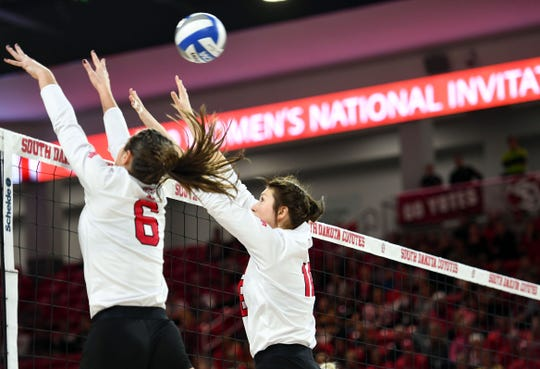 Elizabeth Juhnke and Maddie Wiedenfeld of USD block a ball hit by Georgia Tech in the National Invitational Volleyball Championship game on Tuesday, Dec. 17, at the Sanford Coyote Sports Center in Vermillion.