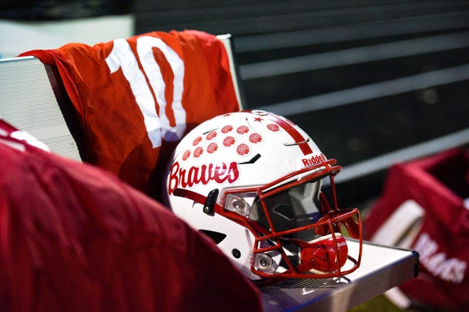 Trevor Zuehlke's jersey and helmet are arranged on the bench during Britton-Hecla's game against Burke on Thursday, October 31, 2019 in Britton. Zuehlke was in a medically-induced coma after a serious head injury he sustained while playing.
