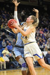 Tagyn Larson goes up for a shot Tuesday against Marquette. She had 22 points in SDSU's loss.
