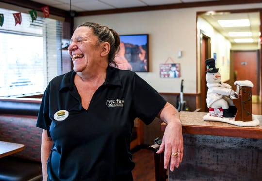 Waitress Cory Criner laughs with a group of customers on Wednesday, Dec. 18, 2019 at the Fryn' Pan in Sioux Falls.
