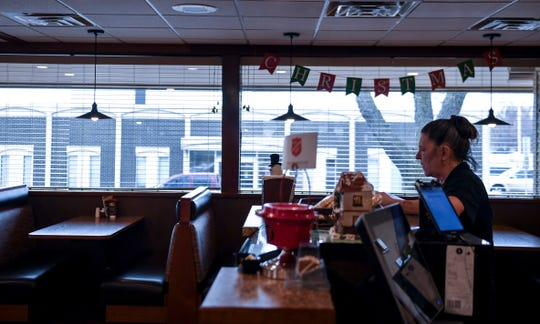 Waitress Cory Criner has a quiet moment during her busy shift on Wednesday, Dec. 18, 2019 at the Fryn' Pan in Sioux Falls.