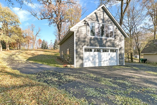 This property features a large detached garage with a loft space.