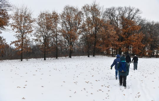 Volunteers walk through fresh powder into the woods for the Christmas Bird Count Wednesday, Dec. 18, 2019, at the Sherburne National Wildlife Refuge.