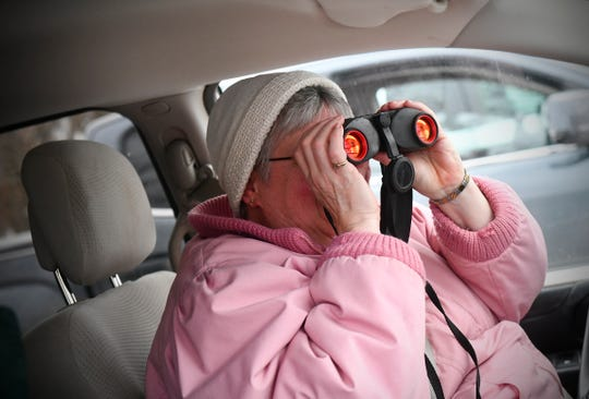 Robin DeLong uses binoculars to spot birds during the Christmas Bird Count Wednesday, Dec. 18, 2019, at the Sherburne National Wildlife Refuge.