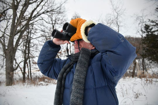 Don Leaon uses binoculars to spot birds during the Christmas Bird Count Wednesday, Dec. 18, 2019, at the Sherburne National Wildlife Refuge.