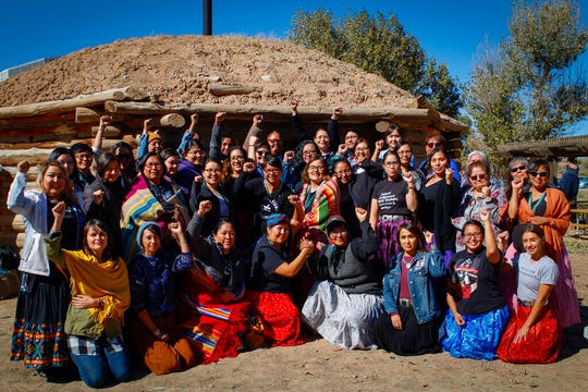 In this Oct. 24, 2019, image, provided by Cronkite News, participants in an indigenous doula training, coordinated by Changing Woman Initiative, pose for a photo outside of a hogan in Window Rock, Arizona. (Delia Johnson/Cronkite News via AP)