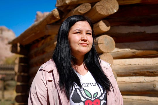 In this Oct. 24, 2019, image, provided by Cronkite News, midwife and doula trainer Melissa Brown poses for a photo in Window Rock, Arizona. Brown, part Navajo and Anishinaabe, had a traumatic experience when she first gave birth as a teen and now provides doula training to help empower indigenous women both in the United States and Canada. (Delia Johnson/Cronkite News via AP)