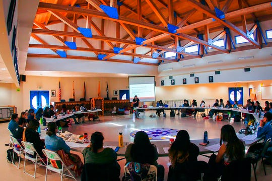 This Oct. 24, 2019, photo provided by Cronkite News, shows indigenous women learning some of the basics of being a doula during a workshop in Window Rock, Arizona. (Delia Johnson/Cronkite News via AP)
