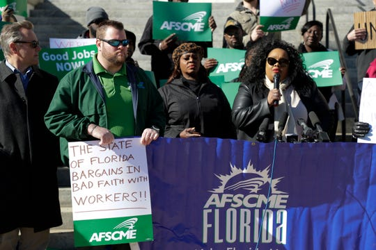 Around 30 state workers marched from the corner of College Avenue and Monroe Street to the Capitol where they gathered to ask Gov. Ron DeSantis for higher wages Wednesday, Dec. 18, 2019.