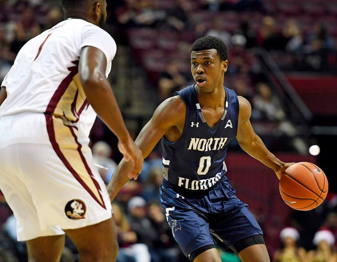 Emmanuel Adedoyin (0) of the University of North Florida Ospreys looks for an opening against Florida State last season in Tallahassee. He is among the candidates to start at point guard this season for UNF.