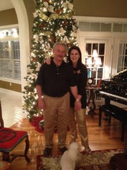 Randy and Starr Clay with one of their many Christmas trees.