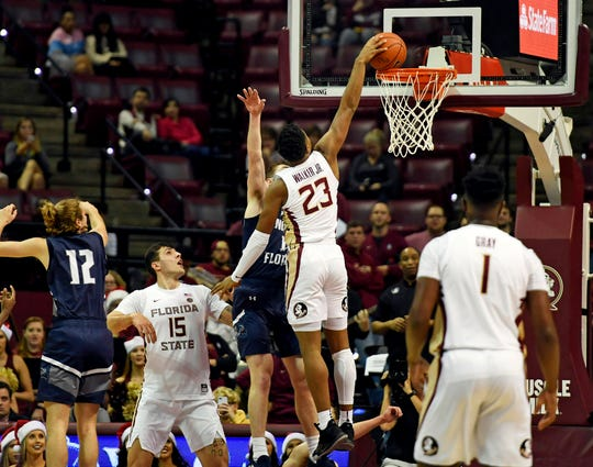 Florida State Seminoles guard MJ Walker (23) dunks the ball during the first half against the North Florida Ospreys at Donald L. Tucker Center.