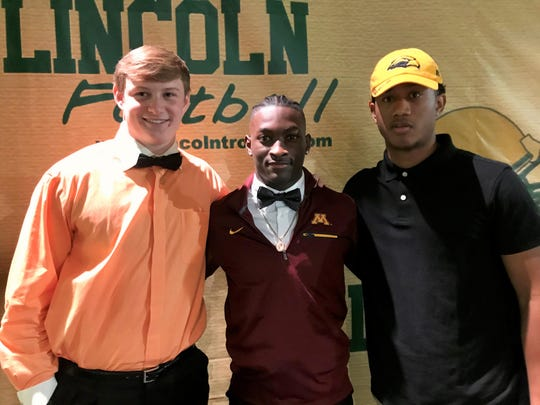 Lincoln High School teammates Sage Ennis (left), Jalen Glaze and Michael Pleas, Jr. officially accepted their college scholarships on early signing day Wednesday, Dec. 18, 2019. Ennis is going to Clemson, Glaze signed with Minnesota and Pleas signed with Southern Miss.