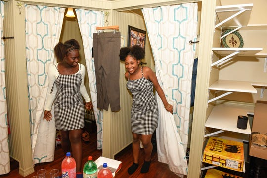 St. Lucie County Boys & Girls Clubs members Bre'yon R. and K'Mylan T. select the same outfit at Whimsy Boutique in Fort Pierce.