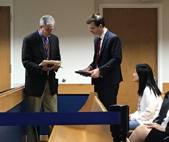 Assistant State Attorney Lev Evans (left), Attorney Baya Harrison (center), Lixia Zhu (right). Harrison is Zhu's defense attorney.