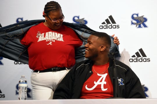 "Ethel Smith, mother of Sebastian River High School defensive lineman Tim Smith, shows her Alabama pride on Wednesday, Dec. 18, 2019, during a National Signing Dy ceremony in the auditorium at the school. Tim Smith signed a letter of intent to play football with the University of Alabama. ""I'm one proud mama,"" Ethel Smith said."