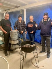 The men in this family, l-r, Gregorio Chavez, Lorenzo Mesta, Armando Aguirre and Manue Fernandez are in charge of overseeing the tamale steaming in pots outside.