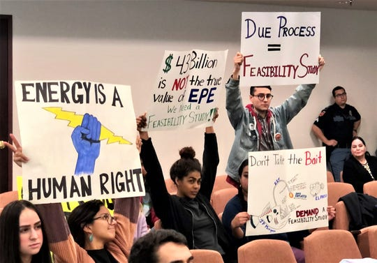 Members of the Sunrise El Paso environmental group protest the pending El Paso Electric sale at the Dec. 17 El Paso City Council meeting.