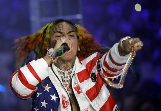 In this Sept. 21, 2018, file photo, rapper Daniel Hernandez, known as Tekashi 6ix9ine, performs during the Philipp Plein women's 2019 Spring-Summer collection, unveiled during Fashion Week in Milan, Italy. Tekashi 6ix9ine was sentenced to two years in prison Wednesday, Dec. 18, 2019, for his entanglement with a violent street gang that fueled his rise to fame, but was spared a much harsher possible sentence because of his extraordinary decision to become a star witness for prosecutors.