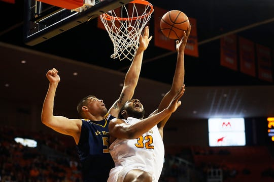 UTEP's Efe Odigie goes against University of California Irvine defense under the net during the game Tuesday, Dec. 17, in the 58th Annual Weststar Bank Don Haskins Sun Bowl Invitational in El Paso.