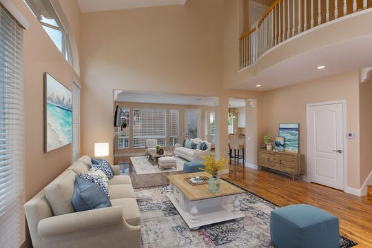 Two-story ceilings in the living room open up this Camarillo home.