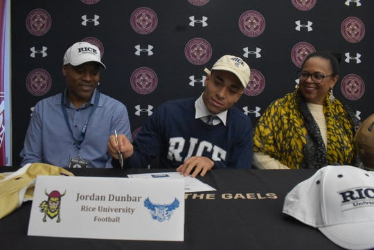 Iona Prep football player Jordan Dunbar signs his National Letter of Intent to play at Rice University during Signing Day on Dec. 18, 2019.