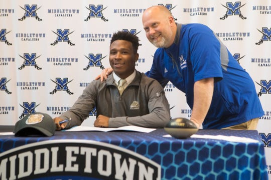 Middletown's T.J. Butler poses for a photo with head football coach Zach Blum after committing to Bryant University to play football Wednesday afternoon.