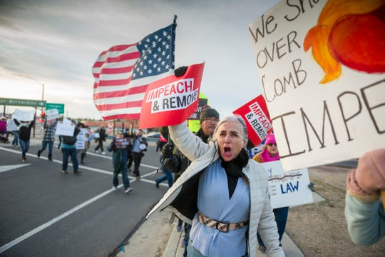 Pro-impeachment supporters demonstrate along Bear Valley Road in Victorville Calif. on Tuesday, Dec. 17, 2019. (James Quigg/The Daily Press via AP)