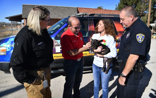 Leslie Harrelson holds Nala, a formerly abused dog, while talking with Animal Control officer Amanda Pfeffer, Crime Stoppers of Wichita Falls Board Vice President David Yonts and Wichita Falls Police officer and Crime Stoppers coordinator Brian Bohn about the newly formed Crime Stoppers Animal Cruelty division. Harrelson will be heading up the new division.
