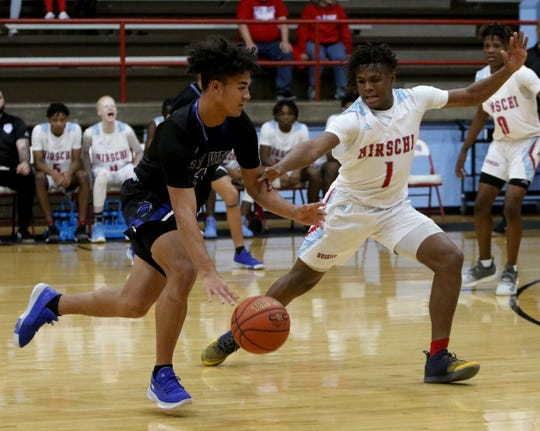 City View's Jayln Marks dribbles by Hirschi's Nate Thompson Tuesday, Dec. 17, 2019, at Hirschi.
