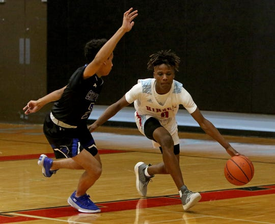 Hirschi's Ernest Young dribbles by City View's Jason Luster Tuesday, Dec. 17, 2019, at Hirschi.