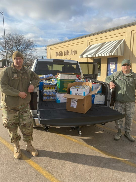 From left, SSgt. Tobias Gilbert and TSgt. Michael Clary drop off more than 3,000 pounds of food to the Wichita Falls Area Food Bank.