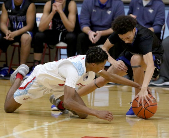 Hirschi's Chris Whitten and City View's Jeremiah Luster go for a loose ball Tuesday, Dec. 17, 2019, at Hirschi.
