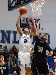 Jalen Moeller-Kile goes up in the lane during the first half against River View's Jordan Bryant during Zanesville's 71-54 win on Tuesday at Winland Memorial Gymnasium.