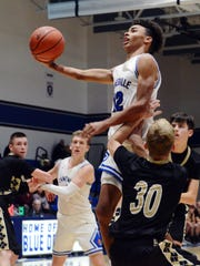 Isaac Mayle soars into the lane for a basket during the second half of Zanesville's 71-54 win against visiting River View on Tuesday night at Winland Memorial Gymnasium.