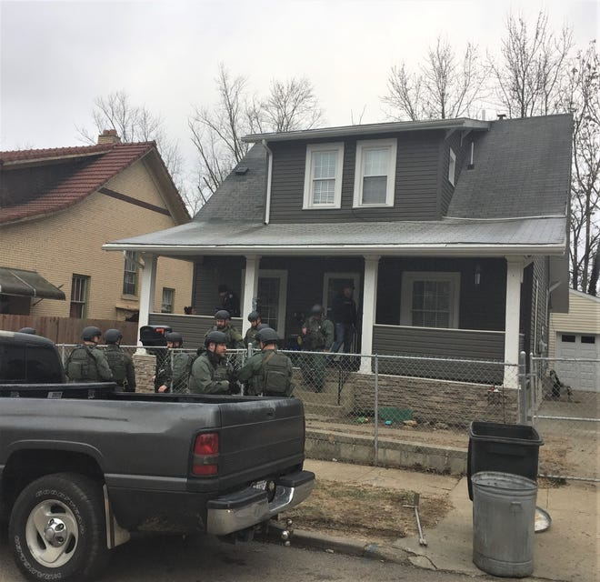 Members of the Zanesville Police Department, Muskingum County Sheriff's Office and Special Response Team raided a residence on Prospect Avenue Wednesday morning following a brief investigation.