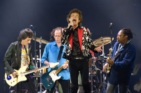 (FromL) Ronnie Wood, Keith Richards, Mick Jagger and Darryl Jones of The Rolling Stones perform onstage at Hard Rock Stadium on August 30, 2019 in Miami Gardens, Florida. (Photo by Michele Eve Sandberg / AFP)MICHELE EVE SANDBERG/AFP/Getty Images ORG XMIT: The Rolli ORIG FILE ID: AFP_1JW4FE