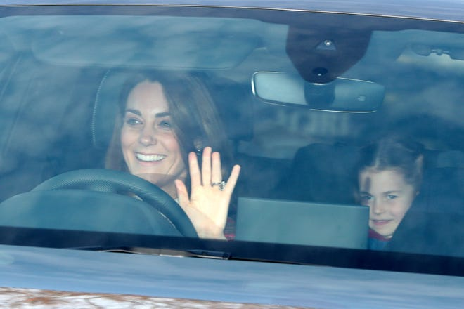 The Duchess of Cambridge and her daughter Princess Charlotte arrive for the Queen's Christmas lunch at Buckingham Palace, London.
