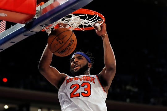 Dec. 17: New York Knicks center Mitchell Robinson dunks the ball against the Atlanta Hawks.