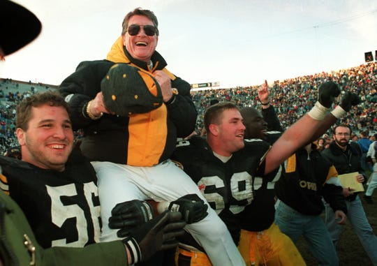 Hayden Fry is carried off the field in 1993 after Iowa defeated Minnesota giving him his 200th career victory.