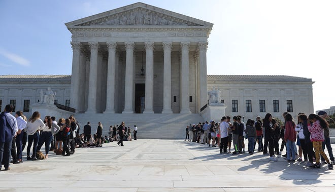 The Supreme Court agreed Wednesday to consider the separation of church and state in employment discrimination cases.