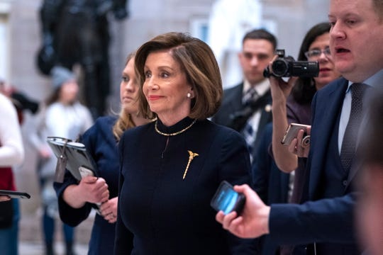 Speaker of the House Nancy Pelosi walks to the House floor to begin debate on votes to officially impeach President Donald Trump on two charges, abuse of power and obstruction of Congress, on Wednesday, December 18, 2019.