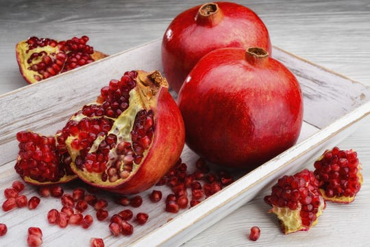 Pomegranate seeds are symbols of abundance. It is a Greek New Year's custom to break seeds on the door's threshold for good luck.