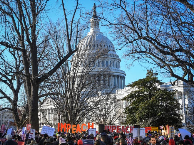 Impeachment supporters rally in Washington, D.C., at the U.S. Capitol on Wednesday, Dec. 18, 2019.
