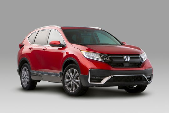 This undated photo provided by Honda shows the 2020 Honda CR-V hybrid, a compact SUV that's expected to get 50% better fuel economy than the standard CR-V. (Courtesy of American Honda Motor Co., Inc. via AP)