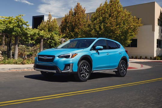 This undated photo provided by Subaru shows the 2020 Subaru Crosstrek Hybrid, a compact SUV that can drive about 17 miles on electricity alone and then switch to a gas engine that averages about 35 mpg. (Subaru of America, Inc. via AP)