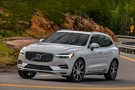 This undated photo provided by Volvo shows the 2020 Volvo XC60 T8, a small luxury SUV that can drive about 20 miles on electricity alone and then switch to a gas engine that averages about 27 mpg. (Volvo Cars of North America, LLC via AP)
