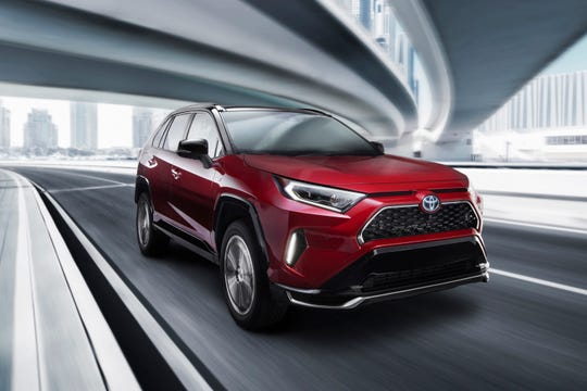 This undated photo provided by Toyota shows the 2021 Toyota RAV4 Prime, a compact SUV that can drive about 39 miles on electricity alone and then switch to a gas engine that averages about 40 mpg. (Maground GmbH/Toyota Motor Sales, U.S.A., Inc. via AP)