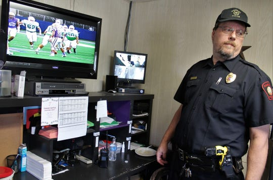 Hamlin Police Chief Bobby Evans reacts when the phone rings just a couple of plays deep into the Pied Pipers' state championship football game with Mart on Thursday morning. He said he'd rather be at the game in Arlington but duty calls.