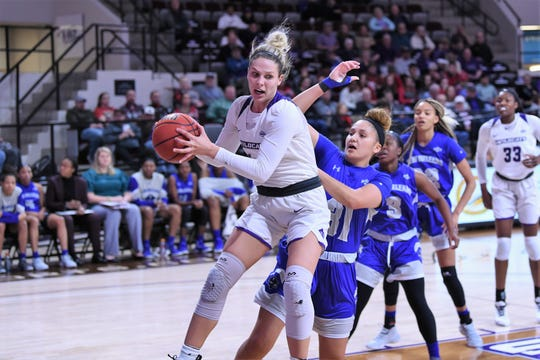 ACU's Lexie Ducat (44) pulls down an offensive rebound against New Orleans in the Southland Conference opener at Moody Coliseum on Wednesday. Ducat had a 12-point, 10-rebound double-double in the 76-62 win.